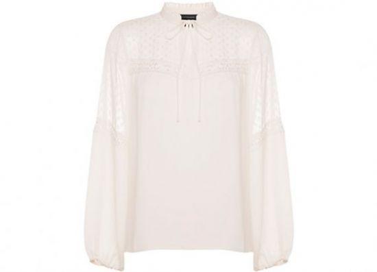 Blusa de volantes blanca