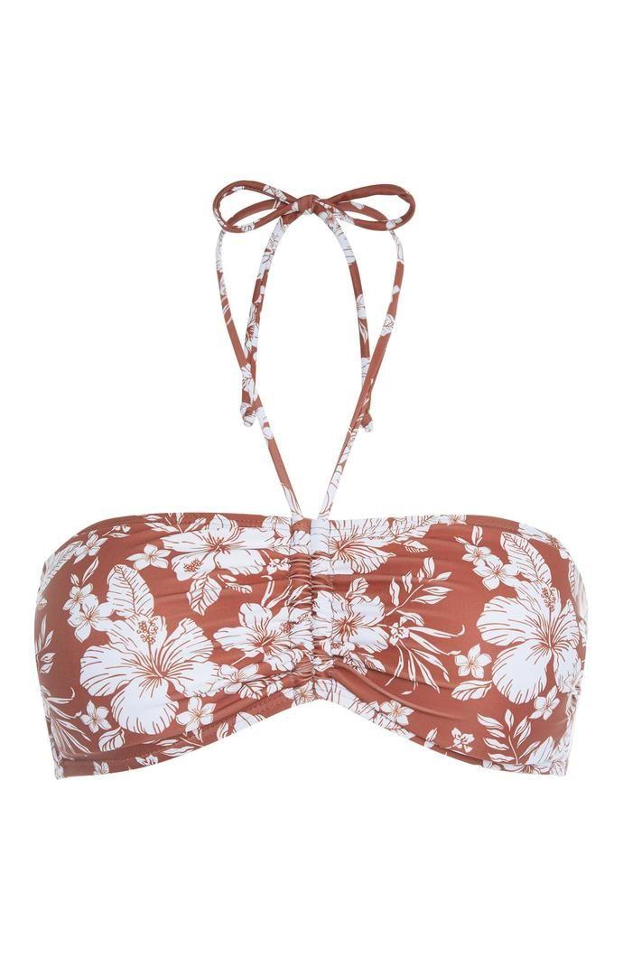 Top de bikini Primark bandeau con estampado floral color teja